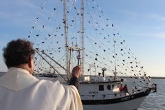 Father Babasino Fernandes blesses Cameron shrimping fleet of 8 vessels